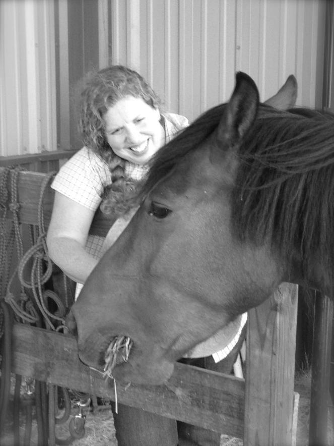 Horse Photo - River chomping hay